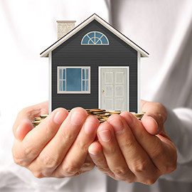 image of a pair of hands holding coins and a tiny model home for the owners section